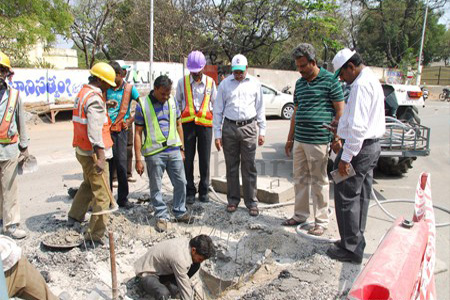 HMR MD Mr. N.V.S.Reddy inspecting road widening work in front of St.Anthony's Church, Mettuguda